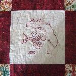 florida state quilt block including the state flower, state bird in redwork